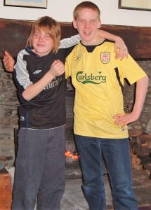 Young Max and Louis wearing football shirts