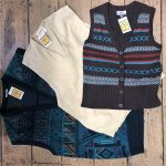 Three sleeveless sweaters - blue, cream and purple/black