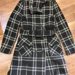 Black and white tartan belted coat